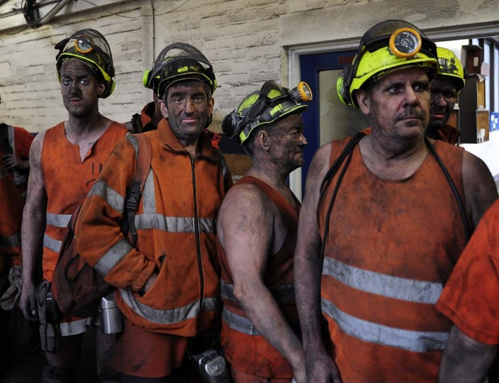 Miners come off the last shift at Kellingley Colliery in Knottingley, northern England, on the final day of production, Friday Dec. 18, 2015. Once, coal fueled the British Empire, employed armies of men and shook the power of governments. On Friday, workers at Britain's last operating deep coal mine finish their final shift. The last haul of coal from the pit is destined for a museum, as a once-mighty industry fades into history.(John Giles/PA via AP)