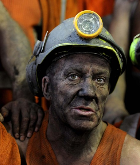 An unidentified miner comes off the last shift at Kellingley Colliery in Knottingley, northern England, on the final day of production, Friday Dec. 18, 2015. Once, coal fueled the British Empire, employed armies of men and shook the power of governments. On Friday, workers at Britain's last operating deep coal mine finish their final shift. The last haul of coal from the pit is destined for a museum, as a once-mighty industry fades into history.(John Giles/PA via AP)
