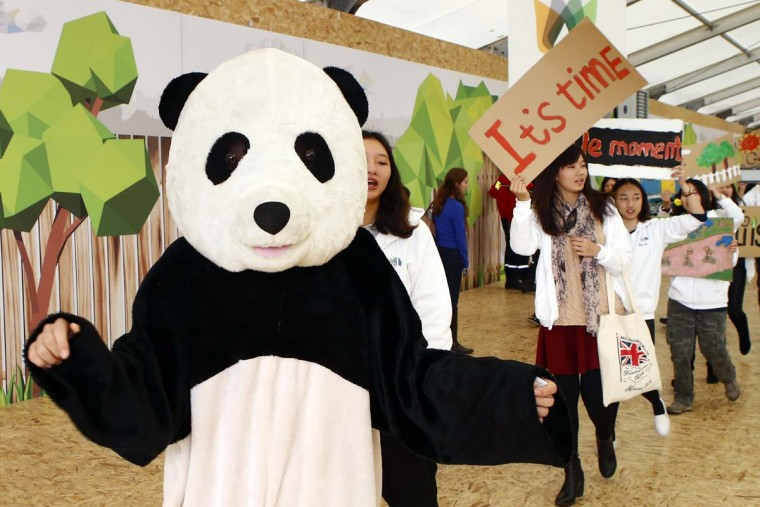 Youths of China Youth Climate Action Network participate to a demonstration march at the Climate Generations Areas as part of the COP21, United Nations Climate Change Conference, in Paris, Thursday, Dec. 3, 2015. || CREDIT: FRANCOIS MORI - AP PHOTO