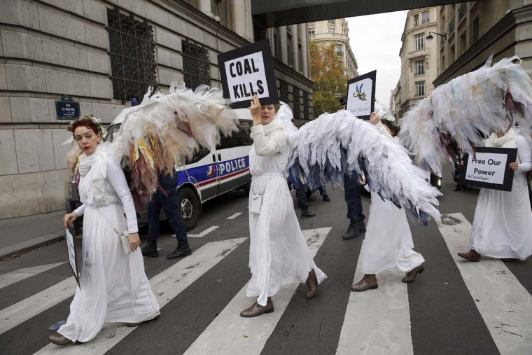"Activists of ""Climacts Angels Guardians"" from Australia arrive for a demonstration in Paris, Thursday, Dec. 3, 2015 . The protest is one of several activist actions linked to the COP21, the United Nations Climate Change Conference.  Many protesters in Paris were  silenced by a demonstration ban this week, though some found creative measures around the edict. 