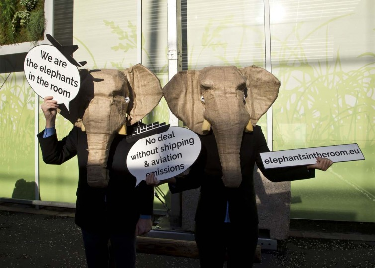 Representatives of NGOs wear elephant masks and hold banners at the COP21, United Nations Climate Change Conference, in Le Bourget, north of Paris, Friday, Dec. 4, 2015. The activists want negotiations over aviation and shipping emissions included in the final accord.  (AP Photo - Michel Euler)