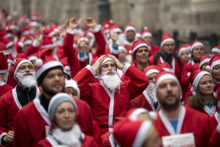 People wearing Santa Claus costumes participate in the 2nd Rossmann Santa Run in Budapest, Hungary, Sunday, Dec. 6, 2015. (Balazs Mohai/MTI via AP)
