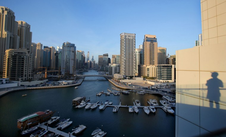 In this April 1, 2015 photo, yachts are moored at the southern end of the Marina waterfront in Dubai, United Arab Emirates. High-rise buildings, stacked row after row, make up this 50 million sq. foot (4.65 million sq .meter) waterfront neighborhood that is built around a man-made canal. Owning an apartment in one of these towers means access to skyline pools, concierge services and grand apartments that cater to the region''s royalty, as well as the world''s wealthiest businessmen and women. (AP Photo/Kamran Jebreili)