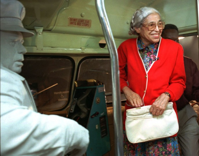 """Rosa Parks visits an exhibit illustrating her bus ride of December 1955 at the National Civil Rights Museum in Memphis, Tenn., on July 15, 1995. Parks visited around the city to inaugurate her three-week """"Freedom Ride"""" throughout the country.  (Troy Glasgow/AP)"""