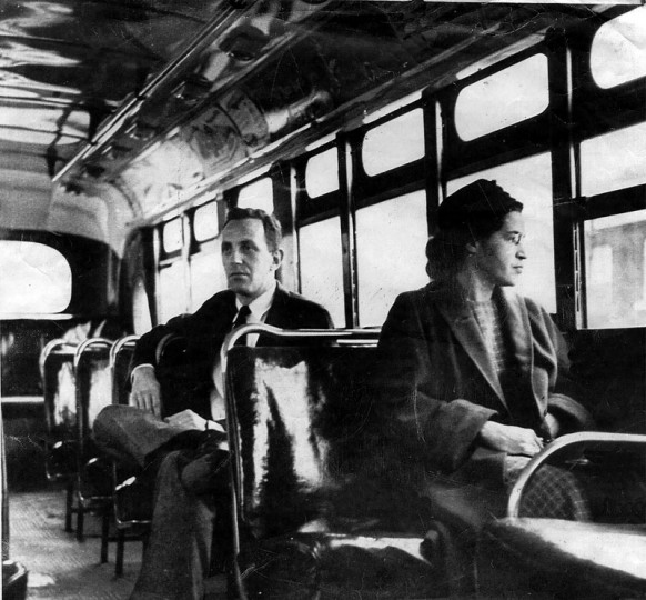 This undated file photo shows Rosa Parks riding on the Montgomery Area Transit System bus in Montgomery, Ala. Parks refused to give up her seat on a Montgomery bus Dec. 1, 1955, and ignited the boycott that led to a federal court ruling against segregation in public transportation. (AP/Daily Advertiser)