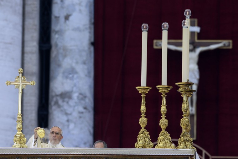 Pope Francis celebrates a Mass prior to the opening of the Holy Door of St. Peter's Basilica, formally starting the Holy Year of Mercy, at the Vatican, Tuesday, Dec. 8, 2015. Francis launched the 12-month jubilee to emphasize what has become the leitmotif of his papacy: to show the merciful and welcoming side of a Catholic Church more often known for its moralizing and judgment. (AP Photo/Gregorio Borgia)