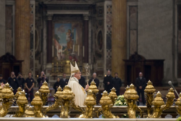 Pope Francis walks inside St. Peter's Basilica, at the Vatican, Tuesday, Dec. 8, 2015. Pope Francis pushed open the great bronze doors of St. Peter's Basilica on Tuesday to launch his Holy Year of Mercy, declaring that mercy trumps moralizing in his Catholic Church. (AP Photo/Andrew Medichini)