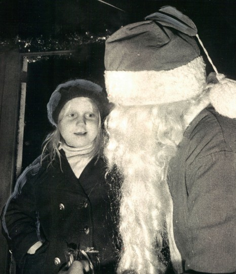 """Tracy Knight, 7: """"No, he's not Santa, really. He's a boy dressed like Santa. I still like to him him though."""" (Irving Phillips/Baltimore Sun, 1972)"""