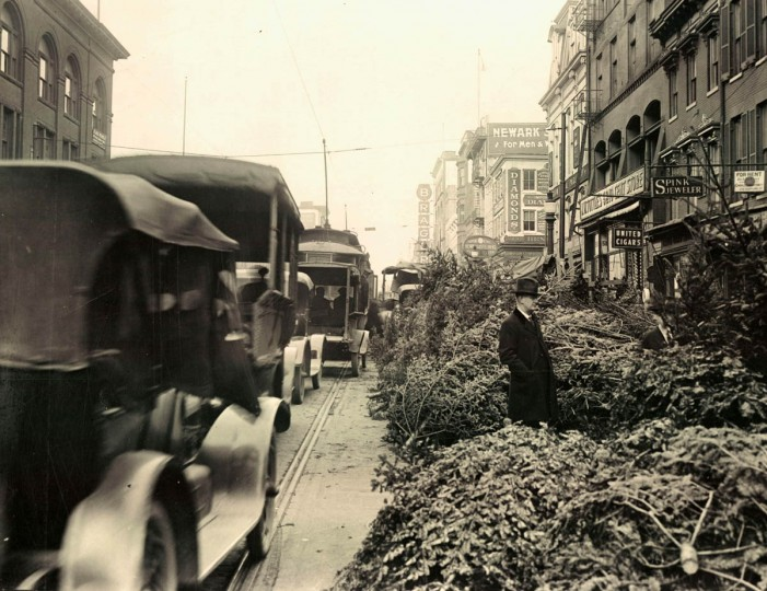 Christmas trees line Eutaw street south of Lexington in 1921. When parking was less of a problem greenery could be sold in the street nearly out to the streetcar tracks. (Baltimore Sun)