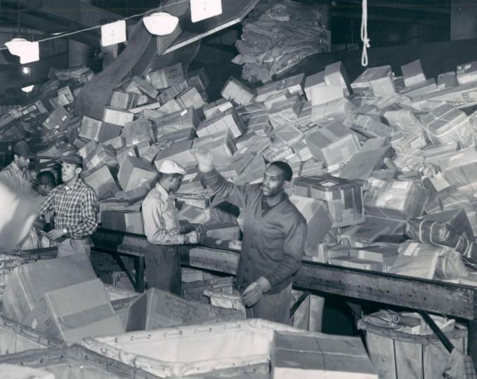 Christmas packages are sorted at the Post Office in Baltimore in 1956. (Frank Gardina/Baltimore Sun)