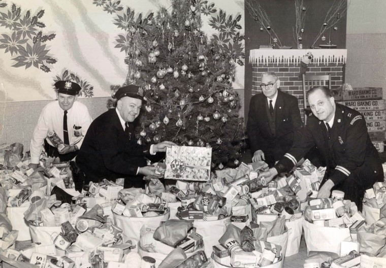 Marion Moraski, Joseph Bocta, August Gribben and Frederick Dunn pack baskets for needy families in 1963 at Southwestern District police headquarters. (William LaForce, Jr/Baltimore Sun)