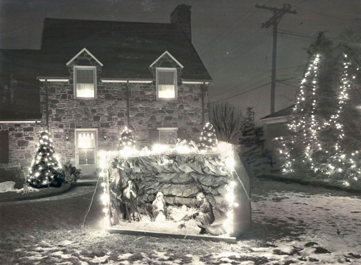 Mrs. Elsie Kinlein of 6707 Loch Raven Boulevard, combined lighted trees and manger scene to achieve a traditional display similar to those to be seen at many churches in the greater Baltimore area in 1966. (A Aubrey Bodine/Baltimore Sun)