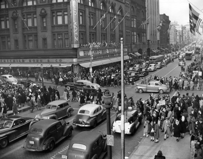Immense mobs converge at the intersection of Lexington and Howard Streets amidst the blare of horns, shouts of pseudo Santas and delighted squeals of misinformed juveniles in 1947. (Robert Mottar/Baltimore Sun)