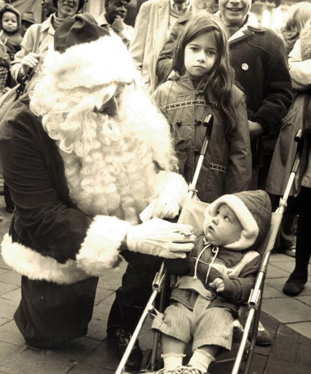 Santa John F. Brown Howard speaks with Nicholas Gradarz of Cockeysville, Maryland at the Lexington Street Mall during The City Downtown Christmas Program in 1975. (Joseph A. DiPaola/Baltimore Sun)