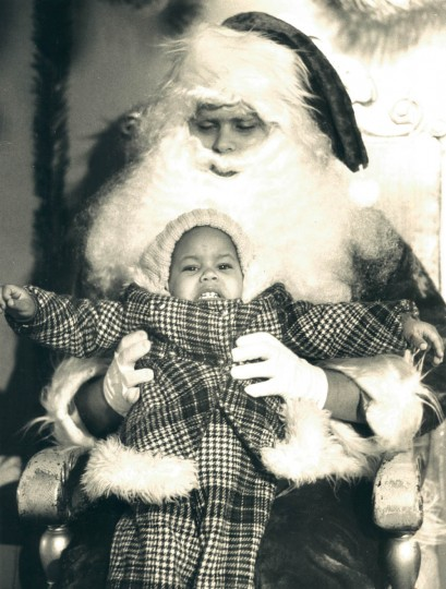 Charmaine Simms, 2, got a little frightened by a heavy Ho! Ho! Ho! from Santa Claus at the Sears department store on North Avenue in 1976. (Lloyd Pearson/Baltimore Sun)
