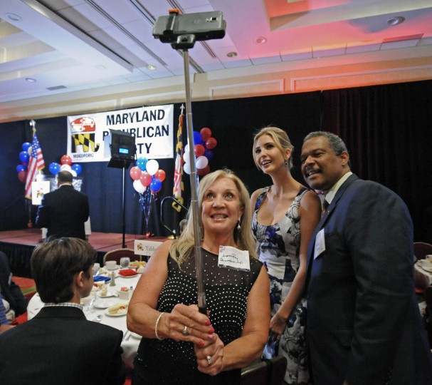 Lynn Roy, left, of Queenstown, Md., uses a selfie stick with her cell phone attached to take pictures of herself with Ivanka Trump and fellow republican Julius Ware at the recent Maryland Republican Party's 25th Annual Red, White and Blue Dinner at the BWI Airport Marriott Hotel. Ivanka's father Donald Trump, who announced his candidacy for the president of the U.S., was the keynote speaker at the fundraiser . (Kenneth K. Lam/Baltimore Sun)