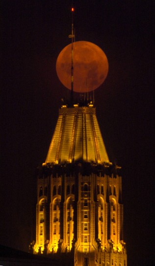 A full Moon, changing to a blood orange color from the particulates in the still night air, makes its way towards the western horizon above the Bank of America building in downtown Baltimore Friday morning, July 2, 2004. According to the Farmer's Almanac, July's full Moon is called the Full Buck Moon or the Full Thunder Moon -- buck deer tend to have their antlers begin to emerge from their heads, and thunderstorms are usually frequent at this time of year. Native Americans may have begun the tradition, naming full Moons as they kept track of the seasons as each full Moon emerged every 29 days. (Karl Merton Ferron/Baltimore Sun)