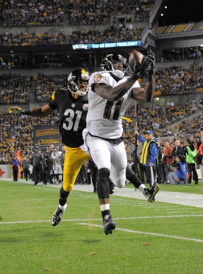 Ravens' Kamar Aiken hauls in a pass from Joe Flacco for a touchdown during the third quarter of the Ravens game against the Steelers at Heinz Field in Pittsburgh. (Karl Merton Ferron/Baltimore Sun)