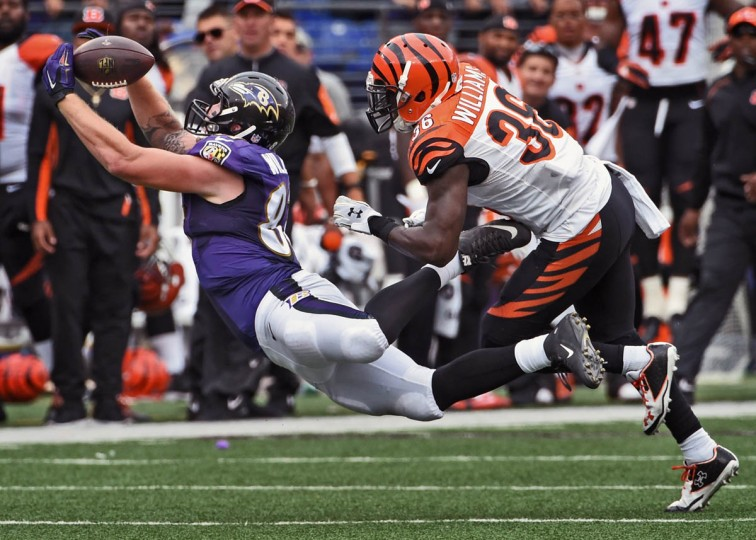 Ravens tight end Maxx Williams, left, was not able to catch this 4th and 17 pass in front of Bengals' Shawn Williams in the fourth quarter. The Ravens turned over the ball on downs to the Bengals ending their hope of a come back win. The Ravens were defeated by the Bengals by a score of 28 to 24 at M&T Bank Stadium. (Kenneth K. Lam/Baltimore Sun)