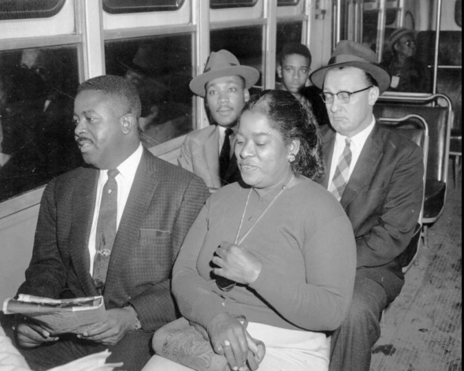 Glenn E. Smiley, right rear, a civil rights activist who advised Martin Luther King, seated next to Smiley, on the techniques of nonviolence. Seated at left foreground is Rev. Ralph Abernathy in this Dec.21, 1963 file photo in which the three men were among the first to ride a bus in Montgomery after the Supreme Court's desegregation order. (AP file photo)