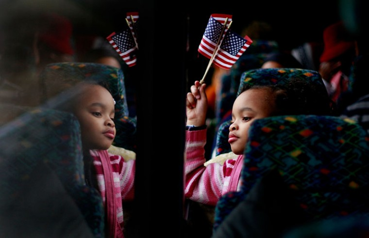 Torri Tippett, 8, from Birmingham, Alabama, rides on a bus with Alabamans on the way to Washington, D.C., to attend the inauguration of President-elect Barack Obama Jan. 19, 2009. (Mario Tama/Getty Images)
