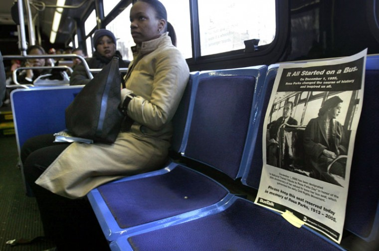"""A poster entitled """"It All Started On A Bus,"""" is posted on the front seat of a New York City bus to honor Rosa Parks in New York, Dec. 1, 2005, the 50th anniversary of the act of civil disobedience by Rosa Parks. (Bebeto Matthews/AP)"""