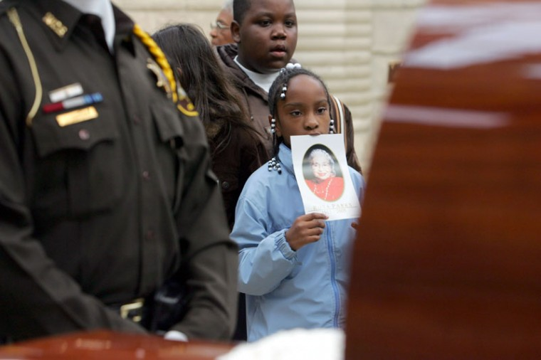 Visitors pay their last respects to Rosa Parks as they file by her casket at the Charles H. Wright Museum of African American History October 31, 2005, in Detroit. (Hugh Grannum-Pool/Getty Images)
