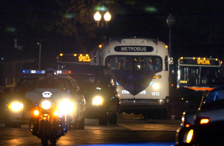 The hearse containing Rosa Parks' casket arrives at the Capitol followed by a 1957 bus and two other Metro buses carrying family members and dignitaries. Parks was the first woman to lie in honor at the Capitol. (KENNETH K. LAM/BALTIMORE SUN)