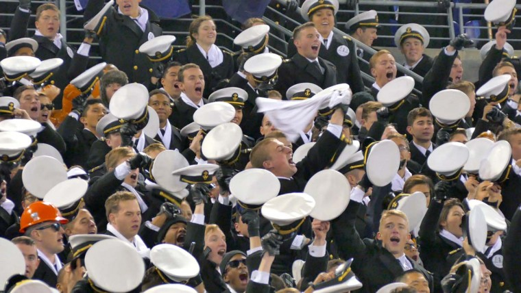 Navy Midshipmen cheer in the stands during the 115th Annual Army Navy game Saturday, Dec 13, 2014. The Midshipmen sank the Black Knights, 17-10. (Karl Merton Ferron / Baltimore Sun)