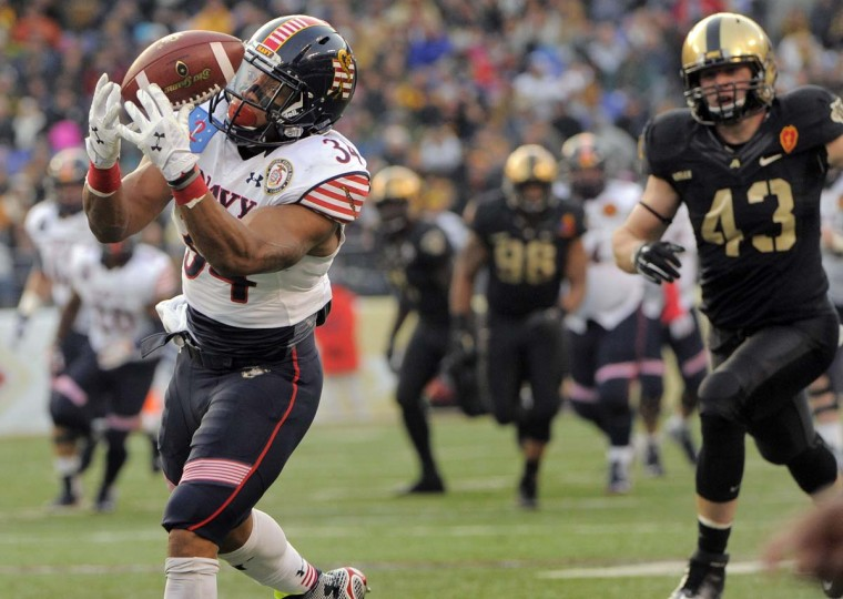 Army Black Knights linebacker James Kelly (43) watches a pass get dropped by Navy Midshipmen fullback Noah Copeland (34) during the second quarter of the 115th Annual Army Navy game Saturday, Dec 13, 2014. (Karl Merton Ferron / Baltimore Sun)