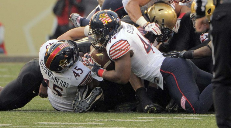 Navy Midshipmen linebacker Obi Uzoma (44) grabs a loose ball that officials claim was ruled dead during the second quarter of the 115th Annual Army Navy game Saturday, Dec 13, 2014. (Karl Merton Ferron / Baltimore Sun)