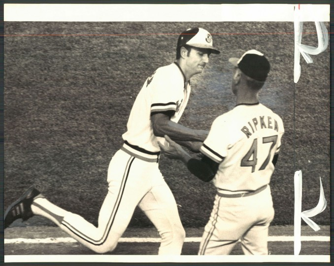 Cal Ripken Sr. congratulates Mark Belanger as he rounds third on a home run on May 26, 1981. (Baltimore Sun photo by William Hotz)