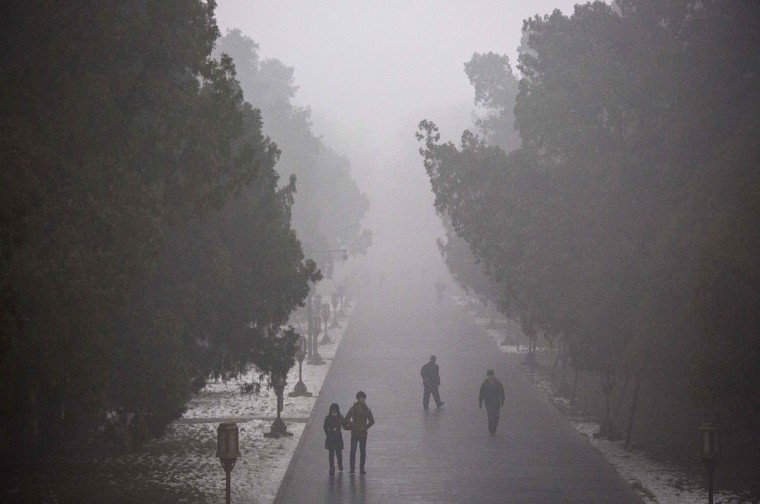 Smog is seen on a day of high pollution at the Temple of Heaven park on December 1, 2015 in Beijing, China. (Photo by Kevin Frayer/Getty Images)