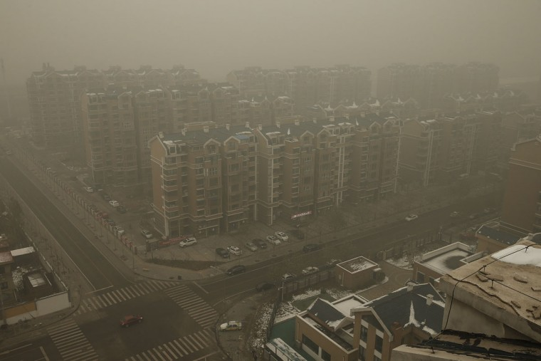 Heavy haze surrounds the a residence community on December 1, 2015 in Beijing, China. (Photo by Lintao Zhang/Getty Images)