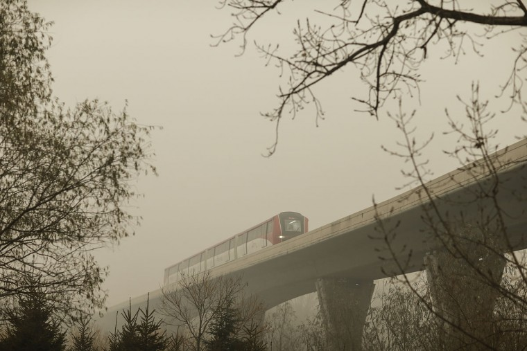A subway passing bridge on a day of heavy pollution on December 1, 2015 in Beijing, China. China's capital and many cities in the northern part of the country recorded the worst smog of the year with air quality devices in some areas unable to read such high levels of pollutants. (Photo by Lintao Zhang/Getty Images)