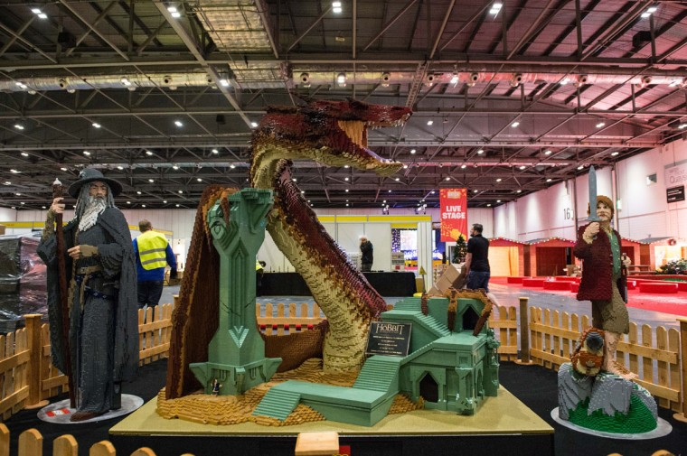 A Hobbit display of Smaug the dragon, made from 83,433 bricks, which took 625 hours to build by the Lego group, with Bilbo Baggins and Gandalf at ExCel on December 10, 2015 in London, England. (Photo by Chris Ratcliffe/Getty Images)