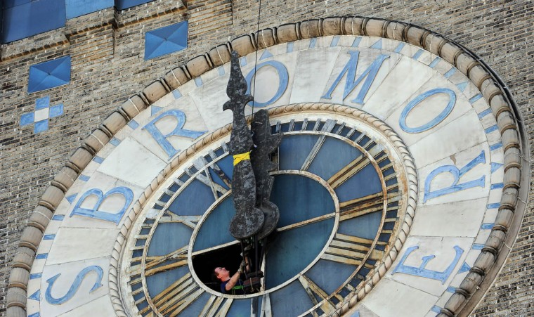 The hands of the Bromo Seltzer clock are being taken down today by Balzer Family Clock Works. The clock and its clockworks will be restored at the company's facility in Freeport, Maine. (Barbara Haddock Taylor, Baltimore Sun)