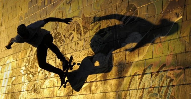 Matt Price of Baltimore rides his skateboard along a wall being highlighted by afternoon sunlight while at the Skatepark of Baltimore. The Skatepark of Baltimore is located in Roosevelt Park. (Lloyd Fox/Baltimore Sun)