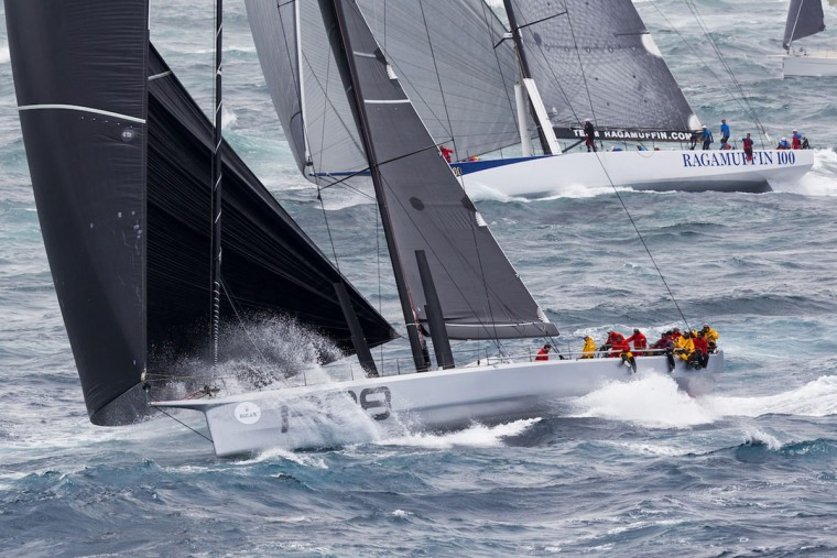 This handout photo from Rolex taken on December 26, 2015 shows US Supermaxi yacht Rambler (left) fighting with Ragamuffin 100 (right) in the Sydney to Hobart yacht race on December 26, 2015. (STEFANO GATTINI/AFP/Getty Images)