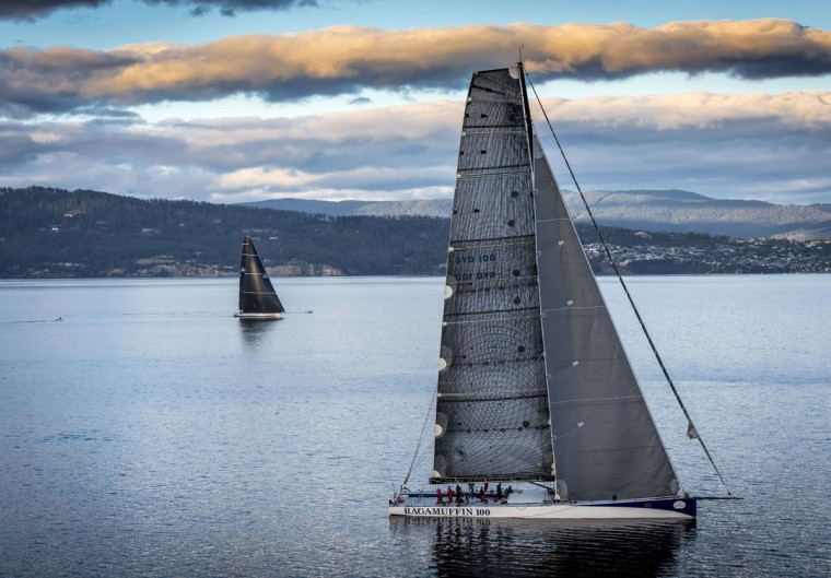 This handout photo from Rolex taken on December 29, 2015 shows Ragamuffin 100 (R) during the Sydney to Hobart yacht race. (Kurt ARRIGO/AFP/Getty Images)