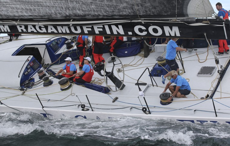 Crew onboard Ragamuffin 100 work during the start of the Sydney Hobart yacht race in Sydney, Australian, Saturday, Dec. 26, 2015. (AP Photo/Rob Griffith)