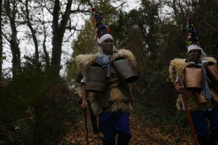 """Men dressed in sheepskins and jingling bells to make noise, and so called """"Zamarracos"""" march during the Vijanera Festival, in the small village of Silio, northern Spain, Sunday, Jan. 3, 2016. The Vijanera masquerade, of pre-Roman origin, is the first carnival of the year in Europe symbolizing the triumph of good over evil and involving the participation of crowds of residents wearing different masks, animal skins and brightly coloured clothing with its own complex function and symbolism and becoming the living example of the survival of archaic cults to nature. (AP Photo/Francisco Seco)"""