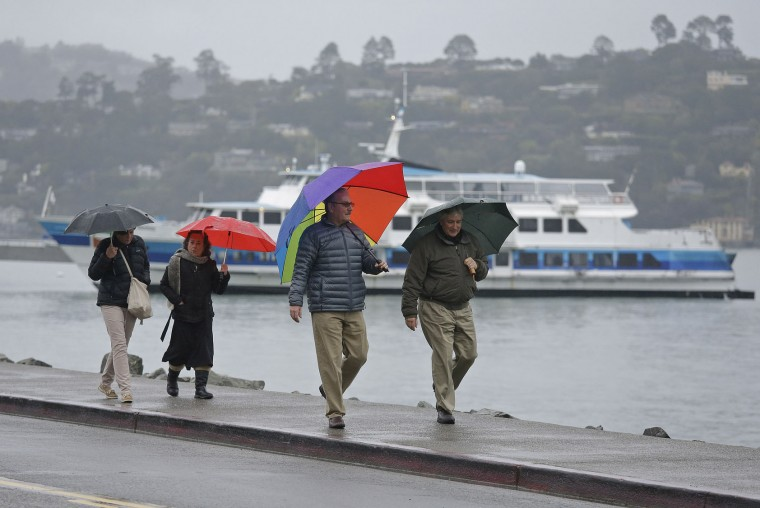 A group of people walk in the rain along the waterfront Tuesday, Jan. 5, 2016, in Sausalito, Calif. Californians were warned against abandoning conservation efforts Tuesday as several weeks of storms spawned by El Nino began hitting the West Coast. Heavy rain and snow are welcome after four years of drought in California, despite their potential for causing flash floods and mudslides. But even a very wet winter won't be enough to replenish water supplies depleted by four years of drought. (AP Photo/Eric Risberg)