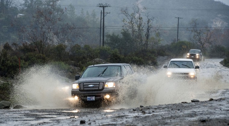 Vehicles make their way along Trabuco Creek Road in Irvine, Calif., through large pockets of water Tuesday morning, Jan. 5, 2016, as the first storm of the season brought rain to Orange County. Californians were warned against abandoning conservation efforts Tuesday as several weeks of storms spawned by El Nino began hitting the West Coast. Heavy rain and snow are welcome after four years of drought in California, despite their potential for causing flash floods and mudslides. (Mark Rightmire/The Orange County Register via AP)