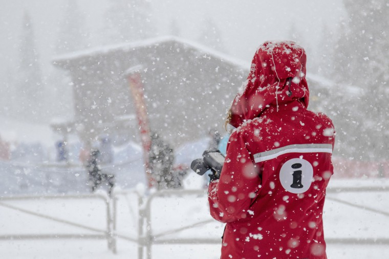 In this photo provided by Northstar California Resort, an employee stands as snow falls at Northstar California Tuesday, Jan. 5, 2016, in Truckee, Calif. Californians were warned against abandoning conservation efforts Tuesday as several weeks of storms spawned by El Nino began hitting the West Coast. Heavy rain and snow are welcome after four years of drought in California, despite their potential for causing flash floods and mudslides. (Northstar California Resort via AP)