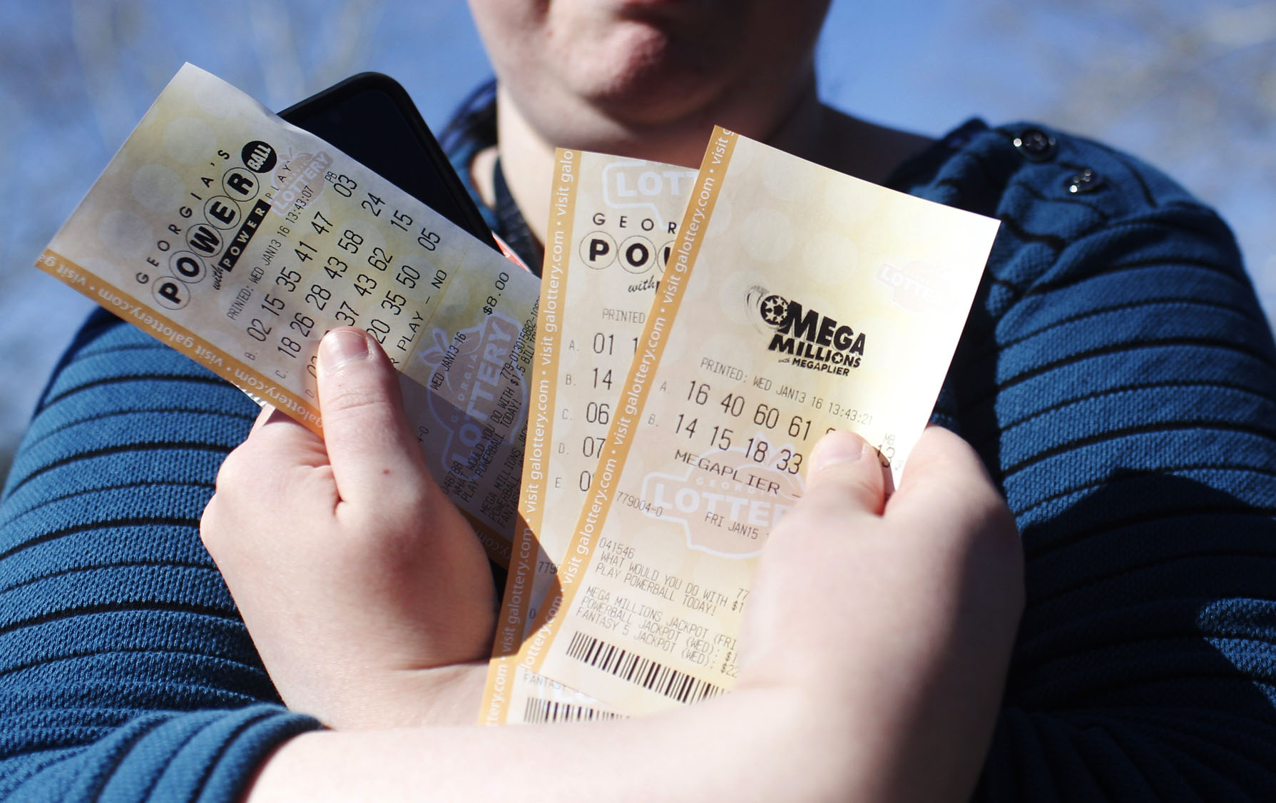Dreams of a Powerball win sweep the nation