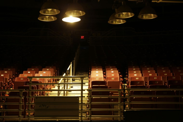 Work lights hang low over empty seats inside the Edward Jones Dome, former home of the St. Louis Rams, Wednesday, Jan. 13, 2016, in St. Louis. NFL owners voted on Tuesday to move the Rams from St. Louis to Los Angeles starting with the 2016 season. (AP Photo/Jeff Roberson)