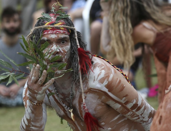 Traditional Aboriginal dancers perform a ceremony on Australia Day in Sydney, Australia, Tuesday, Jan. 26, 2016. Australia Day is the anniversary of the arrival and landing of the First Fleet of convict ships from Great Britain, and the raising of the Union Jack at Sydney Cove by Captain Arthur Phillip, on Jan 26, 1788. (AP Photo/Rob Griffith)