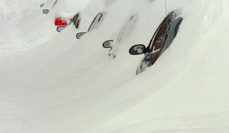February 17, 2003 -- Snow-buried cars are seen in the 700 block S. Patterson Park Ave. (Jed Kirschbaum/Baltimore Sun)