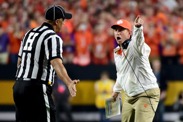 Head coach Dabo Swinney of the Clemson Tigers argues a call with officials during the first half during the 2016 College Football Playoff National Championship Game. (Harry How/Getty Images)